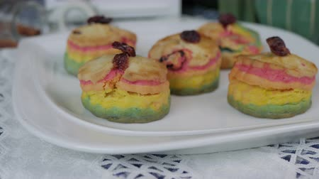 bun : Fresh baked homemade Rainbow Scones cake set on table.