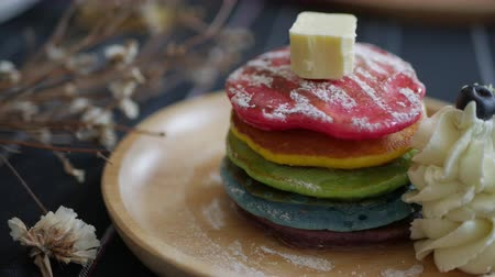 креп : Fresh baked Rainbow Pancake with icing sugar berrie and butter