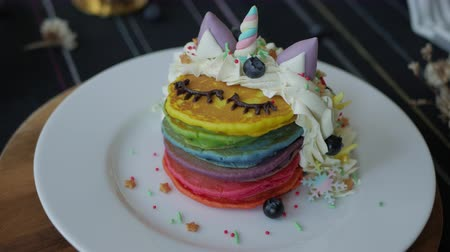 креп : Fresh baked cute unicorn Rainbow Pancake with buttercream berry and decorate sugar. kids meal.
