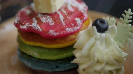 nalesniki : Fresh baked Rainbow Pancake with icing sugar berrie and butter