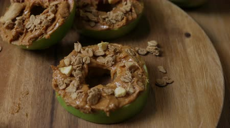 oat flakes : Simple and delicious sliced apple rings topped with peanut butter and granola.