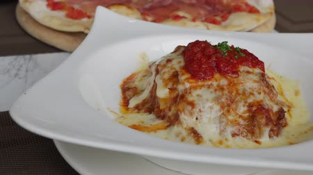 bolonhesa : Traditional Italian beef lasagne serving on white plate in restaurant.