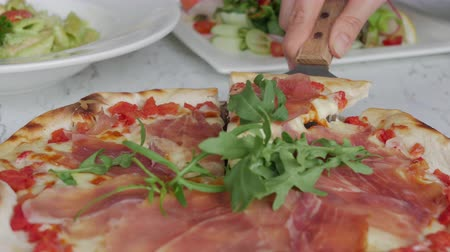 cheese slices : Traditional Italian fresh Prosciutto parma ham pizza serving on restaurant table.