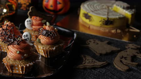 baked pumpkin : Fancy Halloween food Party Table with Pumpkin Cupcake Muffin and cookies.
