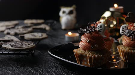 dekoracje : Fancy Halloween food Party Table with Pumpkin Cupcake Muffin and cookies.