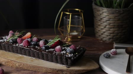 cheese slice : Rectangular Tart Chocolate cheesecake with fresh berries. delicious dessert for celebrate. Set on wooden table background.