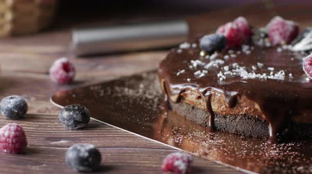 vanilya : Chocolate cream tart cheesecake with fresh berries. delicious dessert for Birthday. Set on wooden table background.