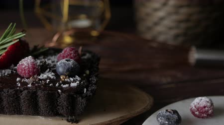 vanilya : Rectangular Tart Chocolate cheesecake with fresh berries. delicious dessert for celebrate. Set on wooden table background.