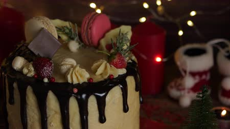 brusinka : Cake for Christmas and winter holidays. Set on wooden dinner table with Christmas decorations.