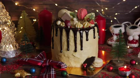 kızılcık : Cake for Christmas and winter holidays. Set on wooden dinner table with Christmas decorations.