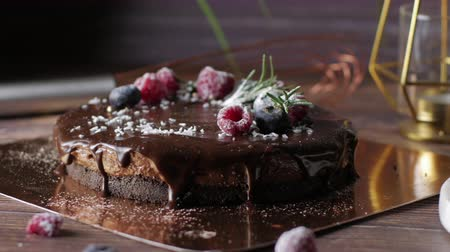 Chocolate cream tart cheesecake with fresh berries. delicious dessert for Birthday. Set on wooden table background.