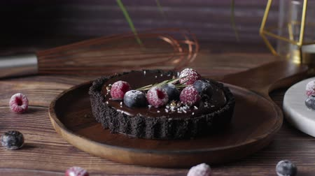 Tart Chocolate cheesecake with fresh berries. delicious dessert for Birthday. Set on wooden table background. Stock mozgókép