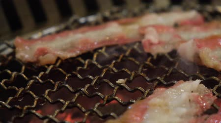 wagyu : Yakiniku Japanse and Korean style BBQ with wagyu bacon beef in restaurant. Stock Footage