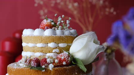 White cake Decorated with flower and berries. For celebrate party weddings, birthdays and events.