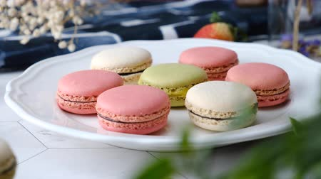 macarons : Colorful French macarons cakes desert set on party table.