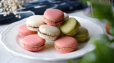Colorful French macarons cakes desert set on party table.