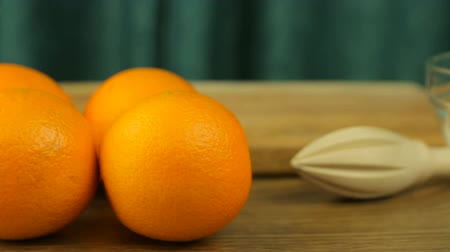 healthyfood : Fresh citrus fruits. Video footage of a healthy diet and diet. Oranges, a juicer, a knife, a bowl and a cutting board