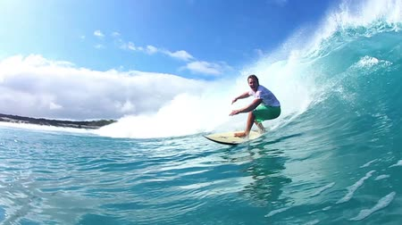 Surfer Riding Blue Ocean Wave