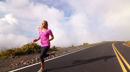 ciało : Young Attractive Fit Blonde Girl Running Above Clouds (Slow Motion)