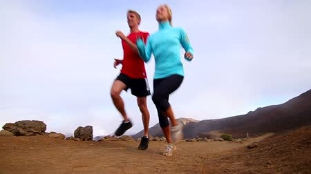 tek başına : Young Active and Fit Couple Trail Running Outside (Slow Motion)