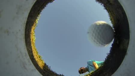 кружка : Man Golfing, POV Shot Inside Hole Looking Out