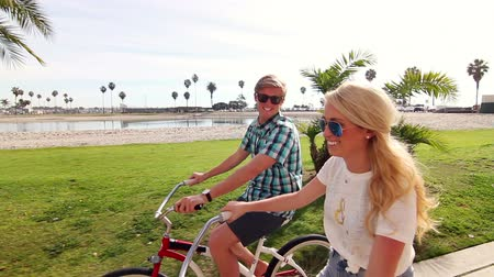 ciclismo : Young Happy Couple Riding Bikes At Beach Slow Motion, Summer Lifestyle HD Stock Footage