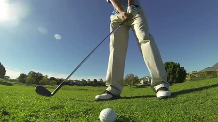 fitnes : Slow Motion - Tight Shot Of Golfer Hitting Ball  Wideo
