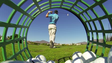тройник : Slow Motion - Golfer Hits Ball Off Tee At Driving Range