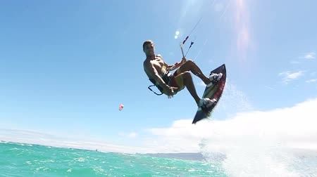 Slow Motion Kite Surfer Doing Extreme Trick