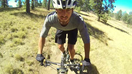 garfos : POV Extreme Mountain Biker Riding Downhill in Meadow