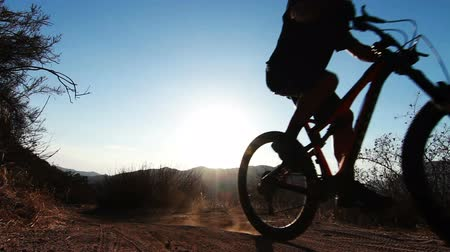 cyclists : Silhouette Man Mountain Biking At Sunset