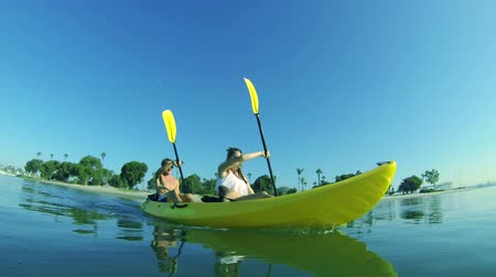 kayak : Slow Motion Young Happy Couple Kayaking Outside In Ocean  Stock Footage