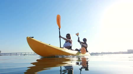 kayak : Young Couple Kayaking Outside Beach Lifestyle
