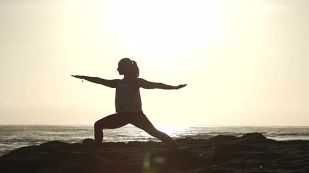 Happy Woman Practicing Yoga Outdoors At The Beach. Wideo