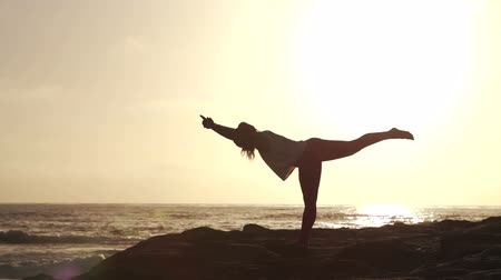 fitnes : Young Woman Silhouette Practicing Yoga On The Beach At Sunset