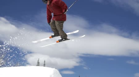snowboard : Man Skiing Does 360 Spin Off Jump