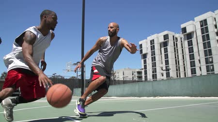 abroncs : Two Basketball Players Playing One on One Outside and Scoring