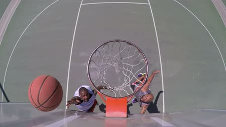 Overhead Angle of Two People Playing Basketball Outside