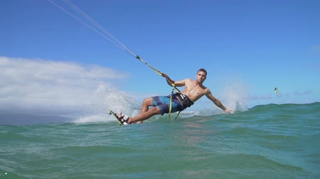Man Kite Boarding In Ocean on Summer Day
