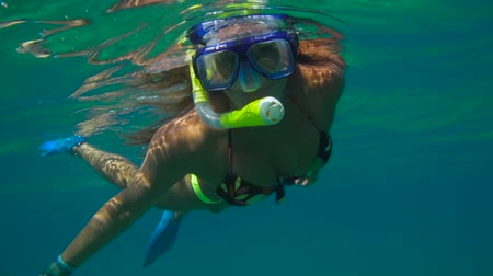 Young Happy Woman Snorkeling Underwater In Blue Tropical Water