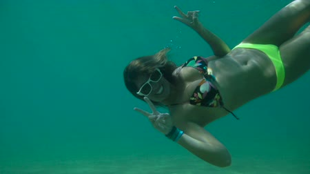 évad : Young Happy Woman Snorkeling Underwater With Peace Sign