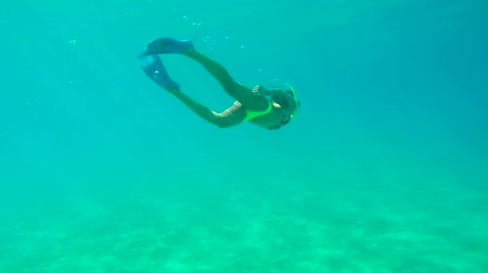 Woman Swimming Underwater in Clear Tropical Water
