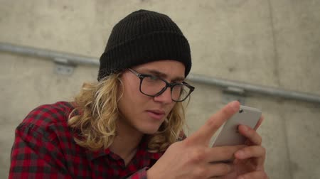 Close Up Shot of Hipster Man With Glasses Looking At Phone Wideo
