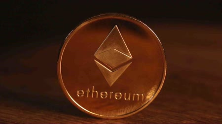 украсть : Macro shot of Ethereum coin rotated on black background