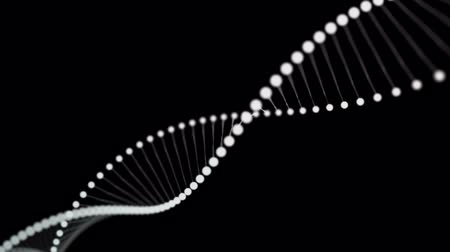 Rotating DNA formed by white luminous molecules on a black background
