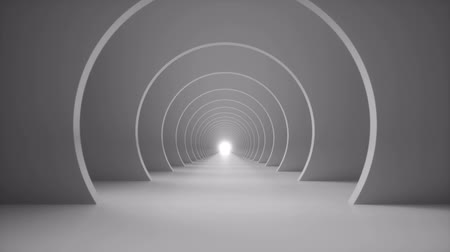 Camera runs into a black and white minimal arch tunnel loop