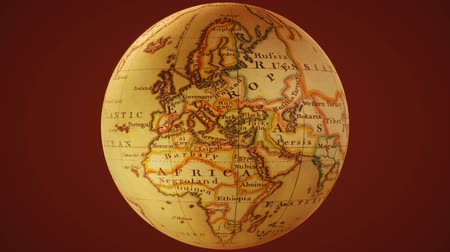 Rotating ancient globe on a red background loop 2 Stock mozgókép