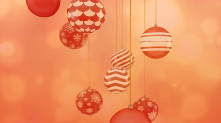 Red christmas balls rotating on a warm red background looping