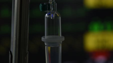 infused water : Close-up view of saline dripping and monitoring on background in operating room