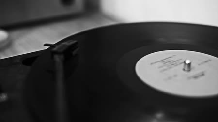 gravar : old turntable plays a record on the table
